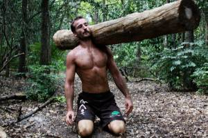 erwan-kneeling_to_lift_log